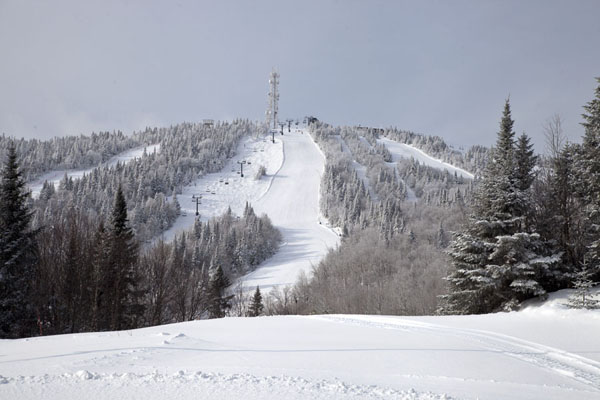 View of the Grand Manitou with wide slopes running down | Mount Tremblant Skiing | Canada