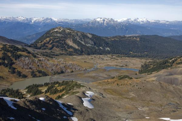 Picture of Panorama Ridge (Canada): Looking over Helm Lake with snow-capped mountains in a distance