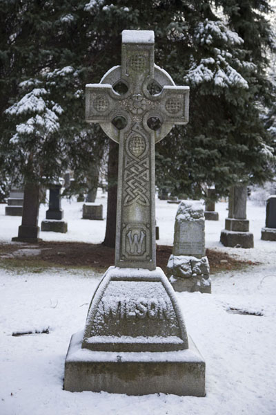 Picture of Toronto Ravine Walk (Canada): Snow-covered tombstone in Mount Pleasant cemetery