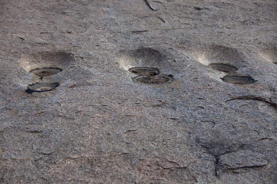 Holes in the rocks: probably created by people grinding grains long time ago | Ab Touyour | Tsjaad