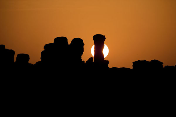 Picture of Sunrise with silhouettes of Ennedi landscape in the foreground - Chad - Africa