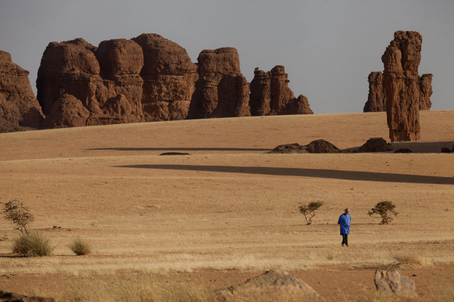 Man walking the plains of Abaike Tassili | Abaike Tassili | Chad