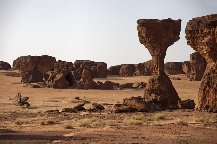 Rock formations, some of them almost impossible, standing in a plain | Abaike Tassili | Chad