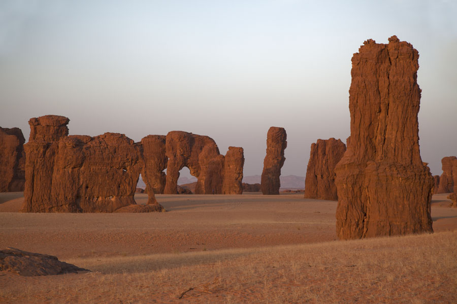 Picture of Collection of rock pinnacles standing on a plain at dusk - Chad - Africa