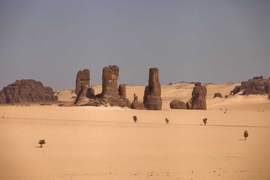 Pillars of rock rising from the desert | Bichagara | Tsjaad