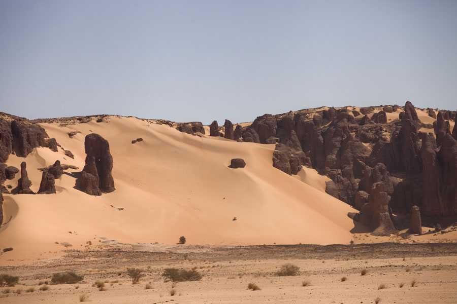 Rock formations with sand dunes | Bichagara | Chad