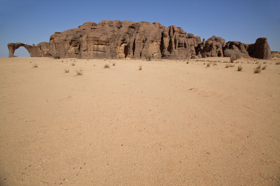 Picture of Bichagara (Chad): Rock formation with arch emerging from the sand floor