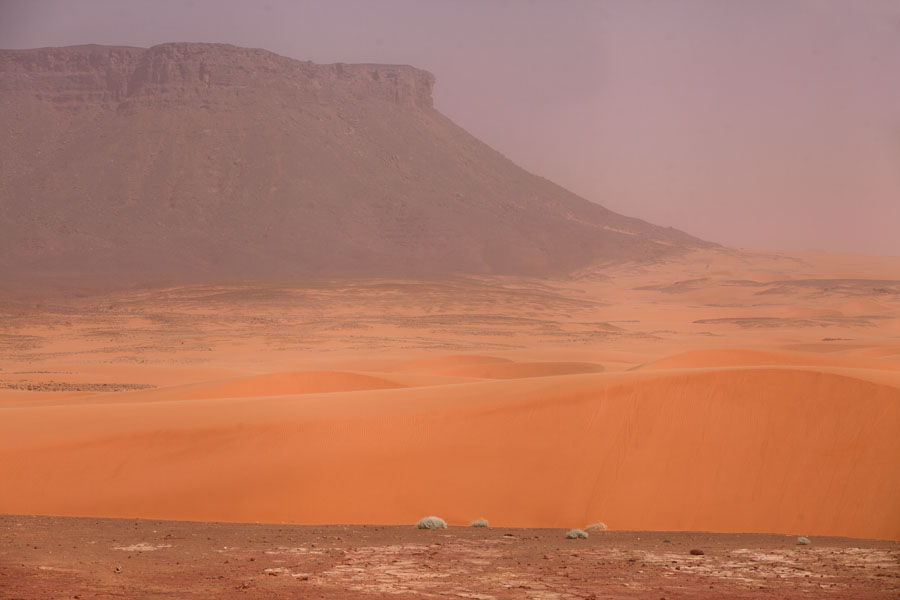 Sand dunes at the foot of a table mountain | Eyo demi | Chad