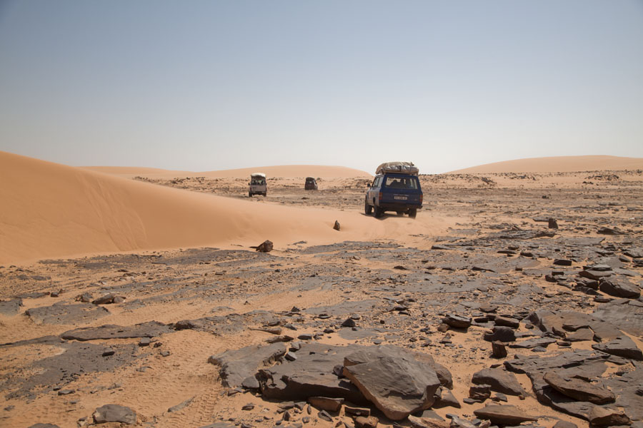 Picture of Landcruisers driving over sandy and rocky terrain - Chad - Africa