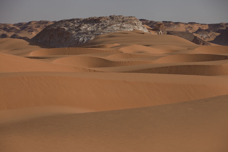 Picture of Sand dunes and rocky mountains in the Ounianga region