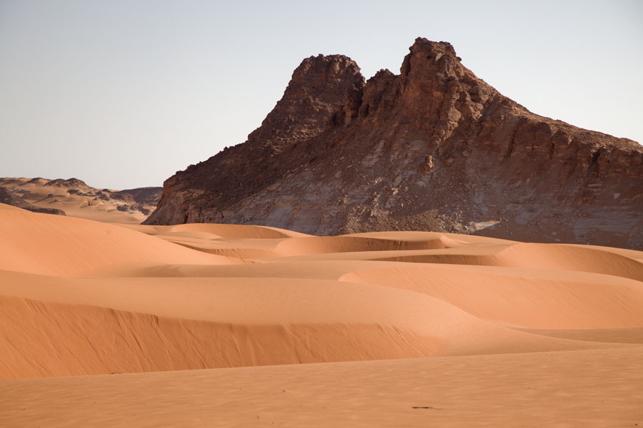Picture of Ounianga Lakes (Chad): Sea of sand dunes at the foot of a rocky mountain