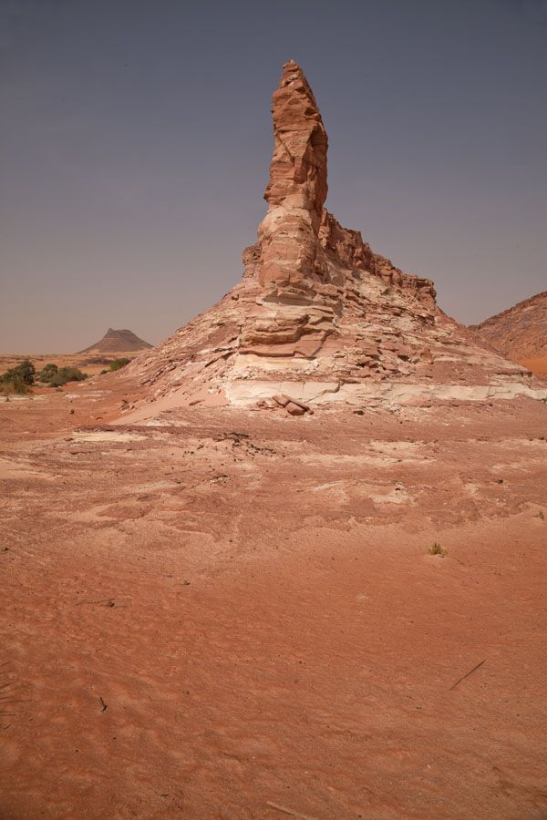 Rock pillar near a salt lake | Teguedei Salt Lakes | 查德
