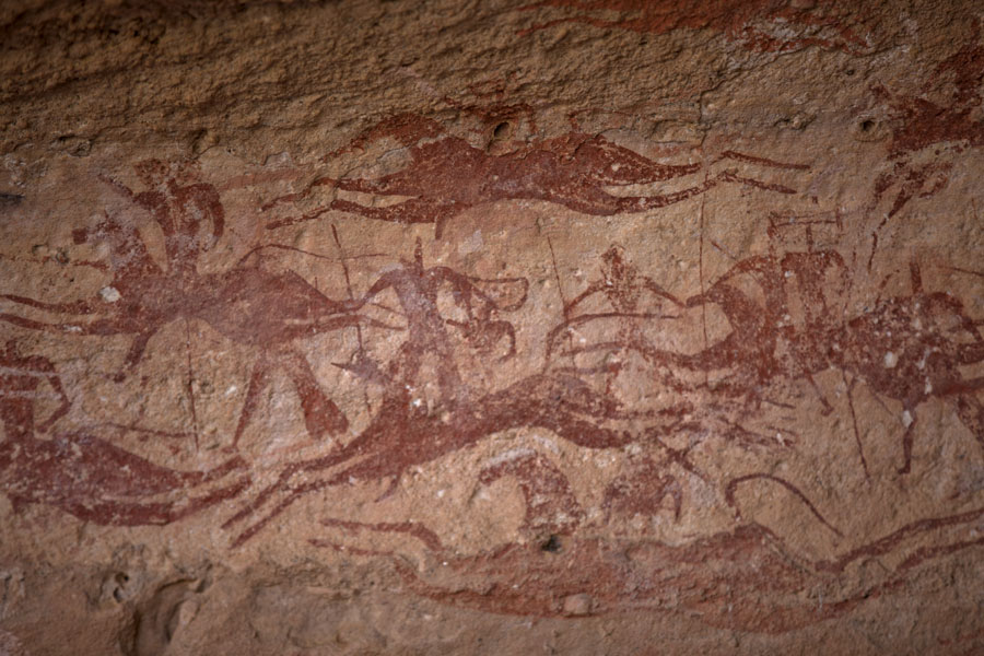 Detail of rock paintings with horses and people on the rocky wall of a cave in Terkei Kisimi | Terkei Kisimi | Chad