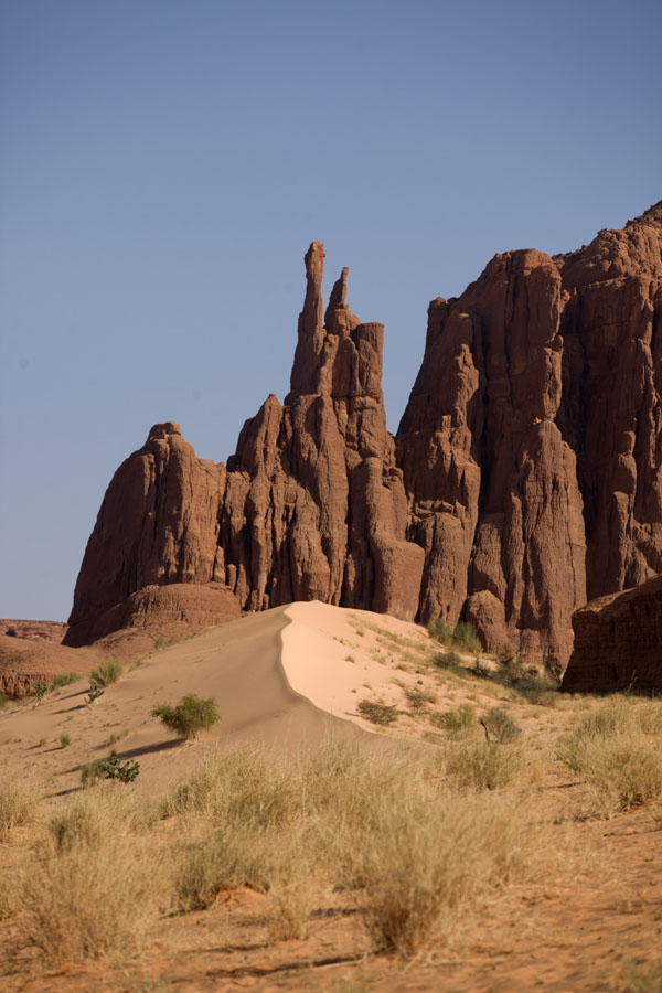 Small sand dune with rock pillars in the background | Tokou massif | Chad