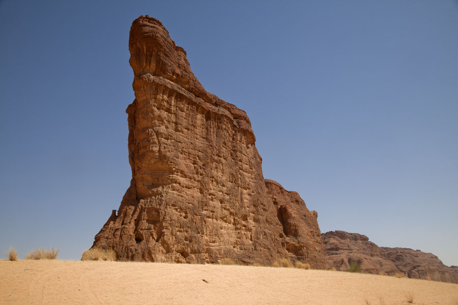 Vertical wall rock formation standing in the desert at Tokou massif | Tokou massif | Chad