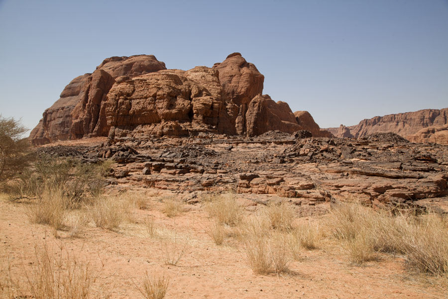 Picture of Pre-islamic tombs in the foreground and a rock formation behind