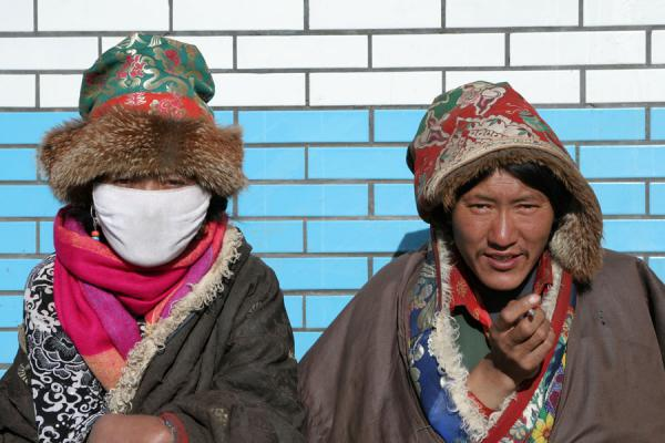 Tibetan woman and man in traditional clothes in Mato | Amdo Tibetans | China