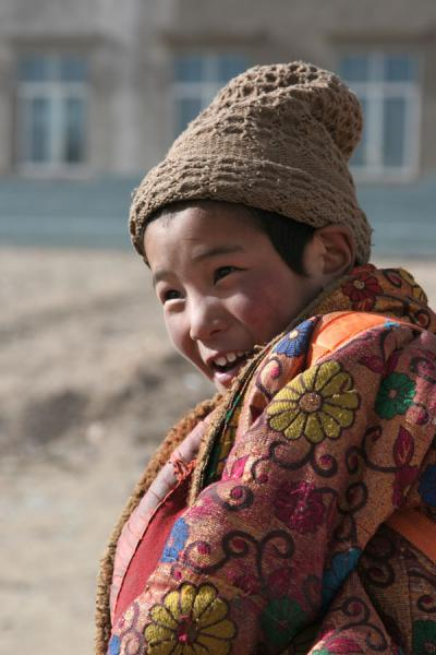 Picture of Afternoon sun shining on Tibetan boy in Mato
