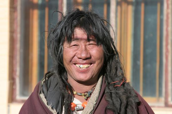 Picture of Broad smile of a friendly and wild looking Amdo man in Mato