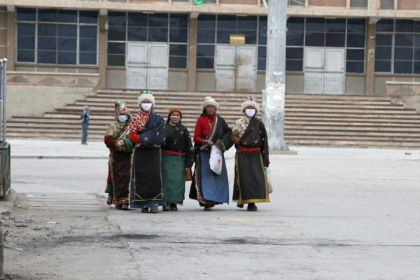 People walking the main street of Mato | Amdo Tibetans | China