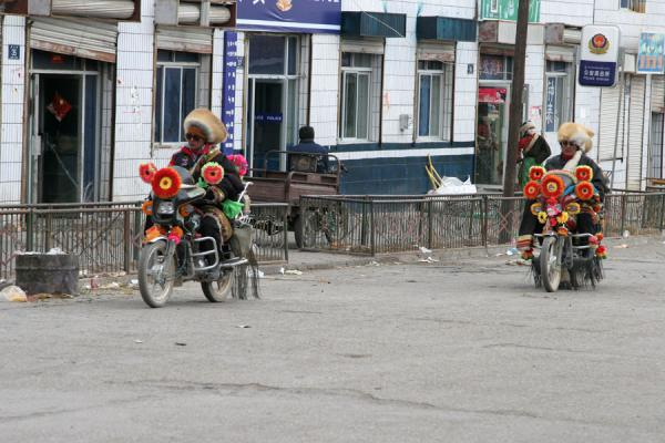 Picture of Amdo Tibetans on colourfully decorated motorbikes