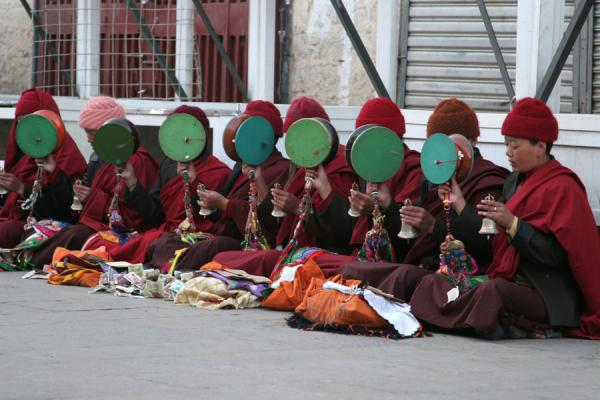 Nuns making music somewhere on the circuit of the Barkhor kora | Barkhor kora | China