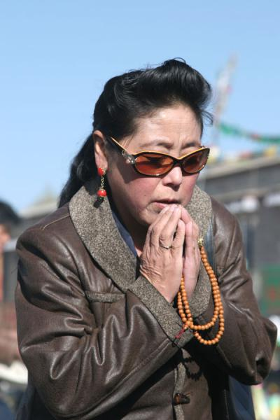 Picture of Barkhor kora (China): Praying on Barkhor square in front of the Jokhang temple