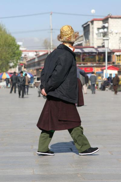 Tibetan pilgrim with traditional hat on Barkhor square | Barkhor kora | China