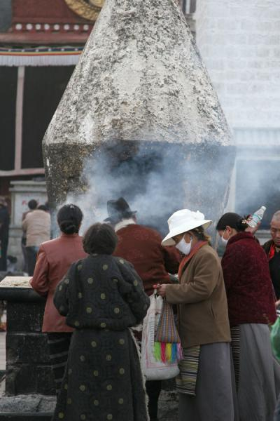 Pilgrims gathering around an incense burner on Barkhor square | Barkhor kora | China