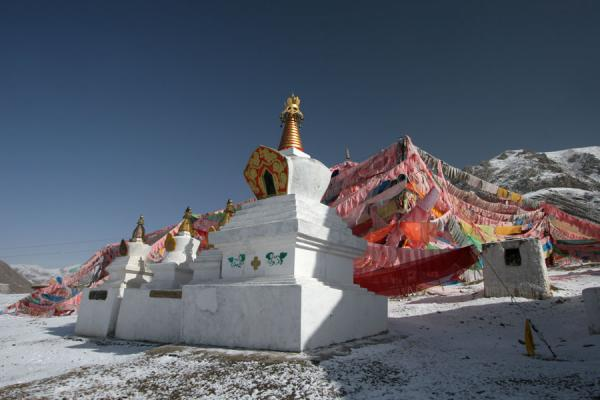 Picture of Batang sky burial (China): Prayer flags and stupas at Batang sky burial site