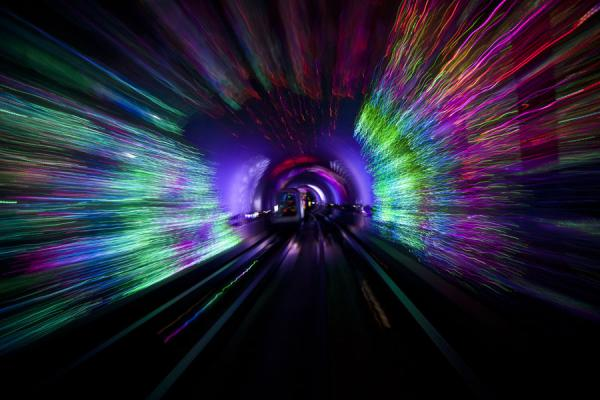 Multicoloured lights in the Bund Sightseeing Tunnel with moving cabin | Shanghai | Cina