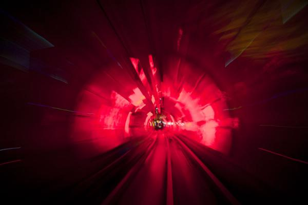 Surrounded by red light in the Bund Sightseeing Tunnel | Shanghai | Cina