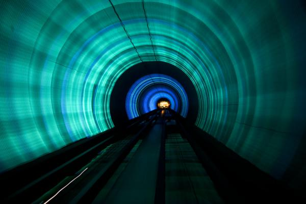 Looking ahead in the Bund Sightseeing Tunnel with blue and green lights | Shanghai | Cina