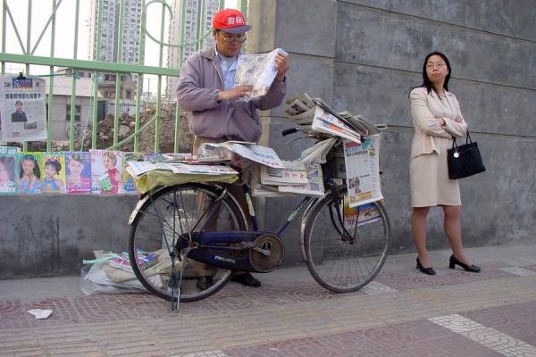 Picture of China bicycles (China): Chinese newspaper seller on bicycle