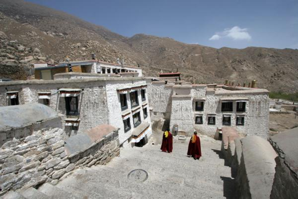 Picture of Drepung monastery (China): Monks walking down the stairs at Drepung monastery