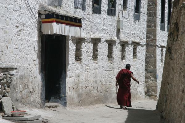 Picture of Alley at Drepung monastery with walking monk