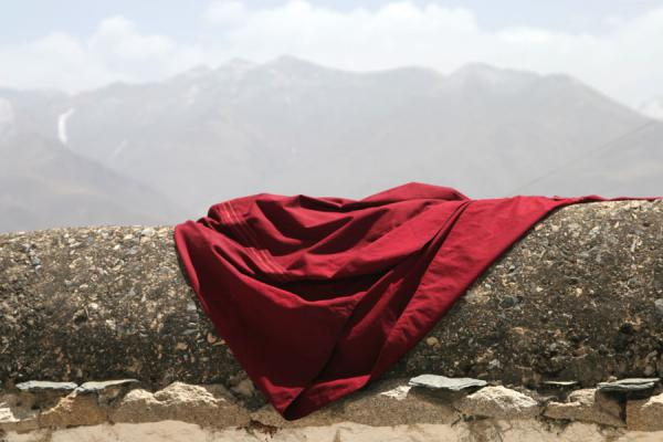 Picture of Drepung monastery (China): Monk robe and mountains at Drepung monastery