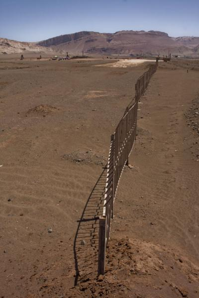 Picture of Flaming Mountains (China): Fence trying to prevent visitors from visiting the Flaming Mountains