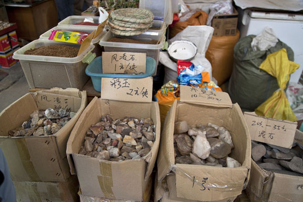 Boxes with various stones and more items at one of the stalls at the market | Flowers, fish, birds and insects market | China