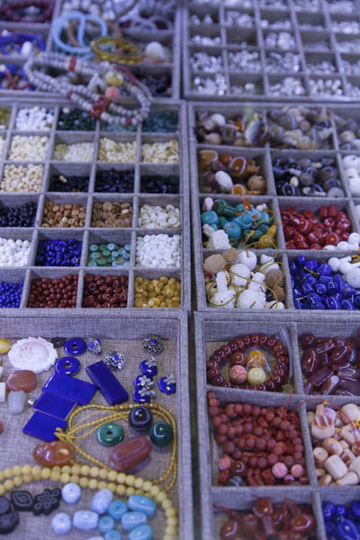 All kinds of small beads for sale at the market | Flowers, fish, birds and insects market | China
