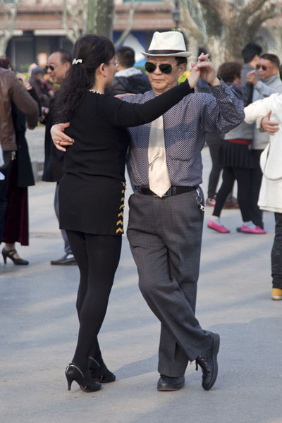 Picture of Couple dancing to classical dance music in Fuxing ParkShanghai - China