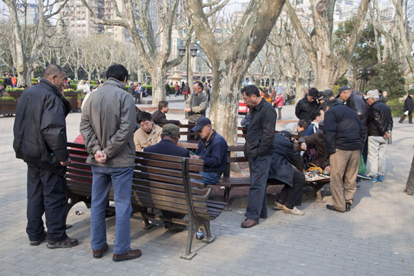 Picture of Chinese people, mostly men, playing games almost everywhere in the parkShanghai - China