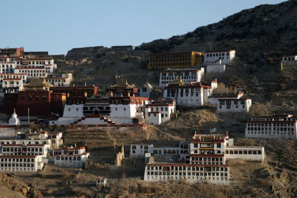 Picture of Ganden Monastery (China): Early morning sun falling over Ganden Monastery