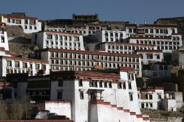 View of part of Ganden monastery in the morning light | Ganden Monastery | China