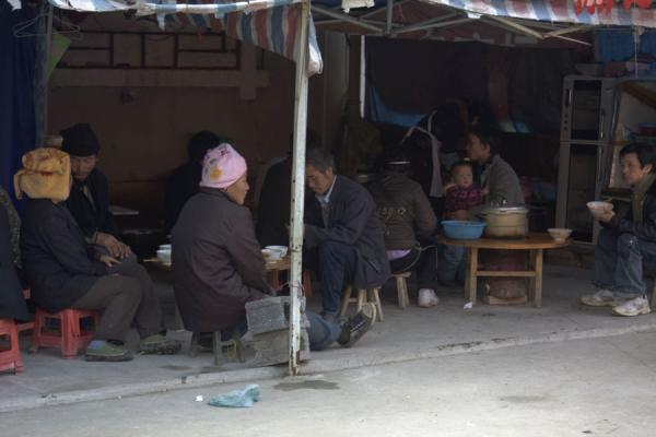 Picture of People having a rest and something to eat in the market