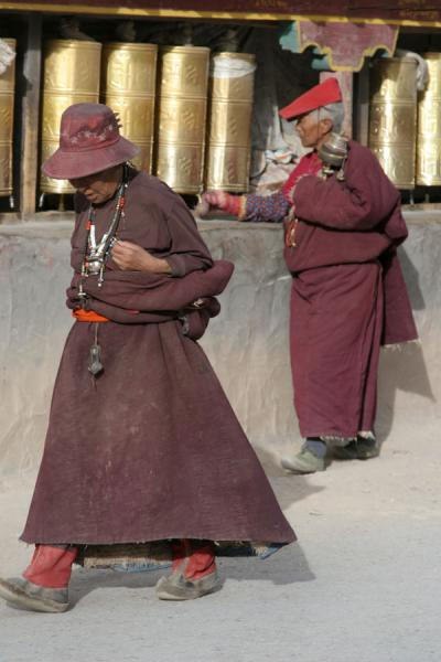 Walking the kora, some do and some do not turn the prayer wheels | Gyanak Mani | China
