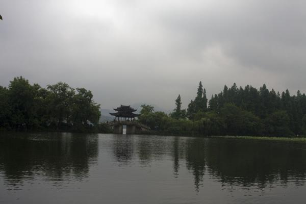 Picture of Trees and covered bridge reflected in an inner lake of Lesser Yingzhou Island on West Lake - China - Asia