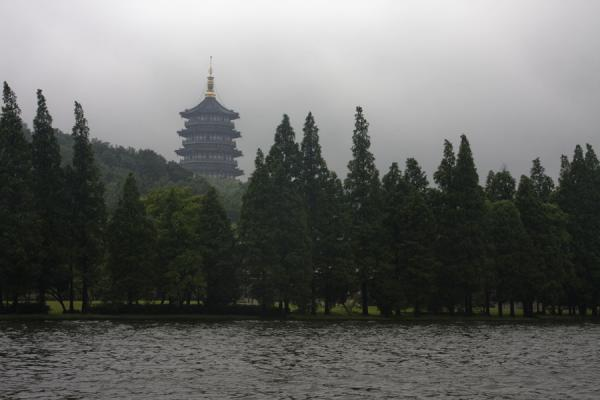 Picture of Leifeng Pagoda towering above the surrounding West Lake and lower hills