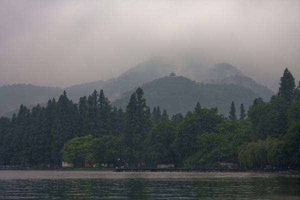 Western coast of the West Lake with mountains disappearing in the fog | West Lake | China