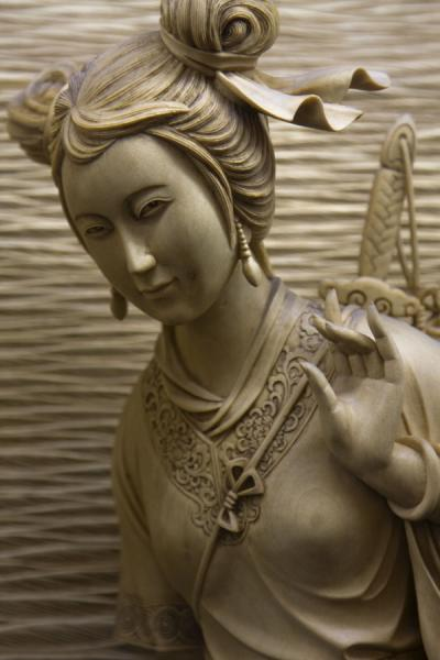 Gracious woman carved out of wood on a panel in the Leifeng Pagoda | West Lake | China